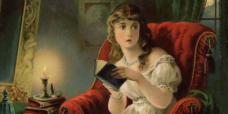 A young Victorian era girl reading by candlelight.