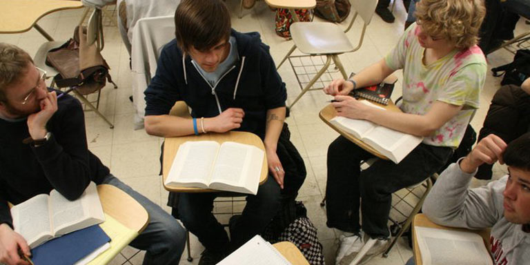 students in a group activity at their desks